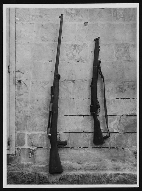 German anti-tank rifle and a British rifle, France, during World War I