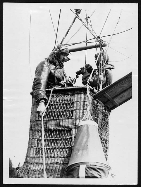 Observers in the basket with telephones and maps