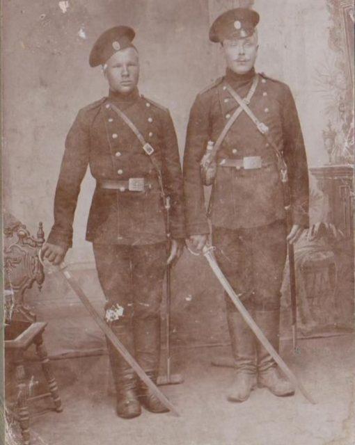 Two men in military uniform. Onega, Arkhangelsk region, Russia, White Sea.