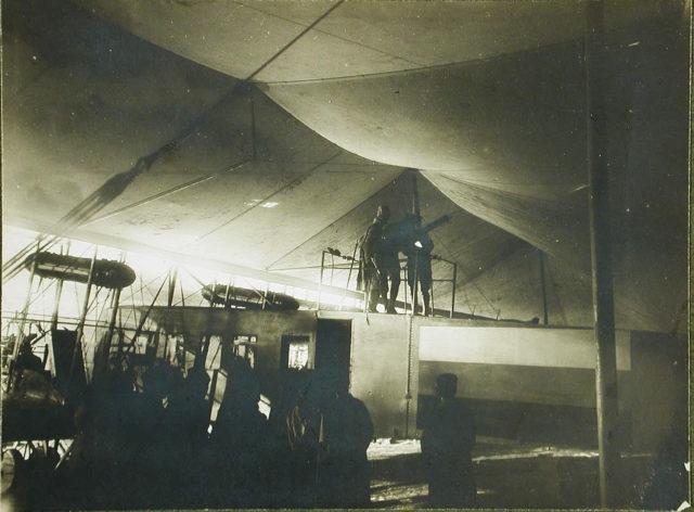 Grand Duke Mikhail Alexandrovich examines the machine gun on the aircraft Ilya Muromets I.