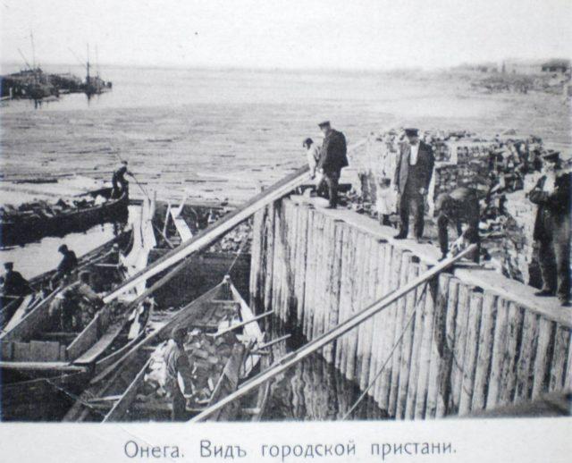 Loading bricks onto boats. Onega Pier, Arkhangelsk region, Russia, White Sea.