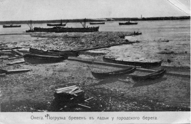 Loading of lumber. Onega Pier, Arkhangelsk region, Russia, White Sea.