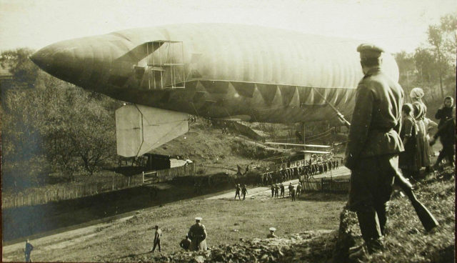 Russian soldiers moving the airship Condor to the parking lot.