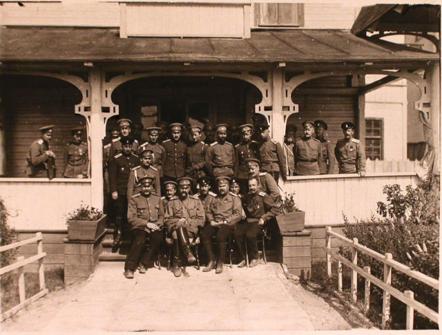 A group of officers the first and seventh avia squad with the Grand Duke Alexander Mikhailovich (sitting second on the left in the foreground). Petrograd.
