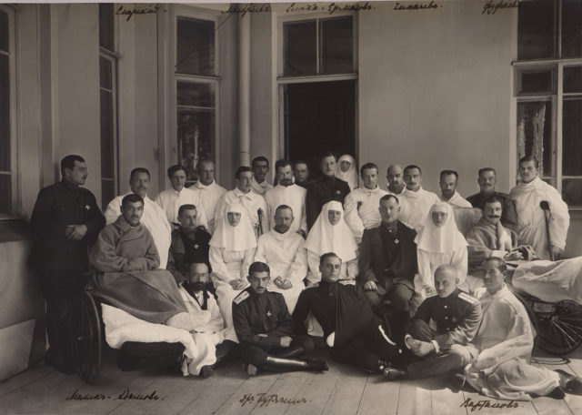 Empress Alexandra Feodorovna, Grand Princess Olga, Grand Princess Tatiana Nikolayevna among the wounded soldiers.