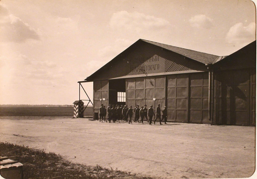 Grand Duke Alexander Mikhailovich (ahead of the group) and accompanying officers from one of the hangars of the Airborne Corps of the Guards Corps during a visit to the avia squads. Petrograd.