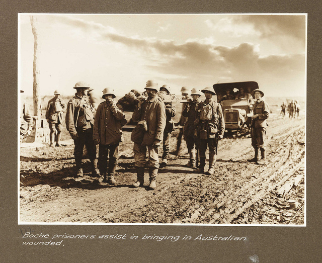 Boche prisoners assist in bringing in Australian wounded
