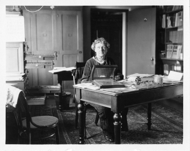 Annie Jump Cannon (1863-1941), sitting at desk