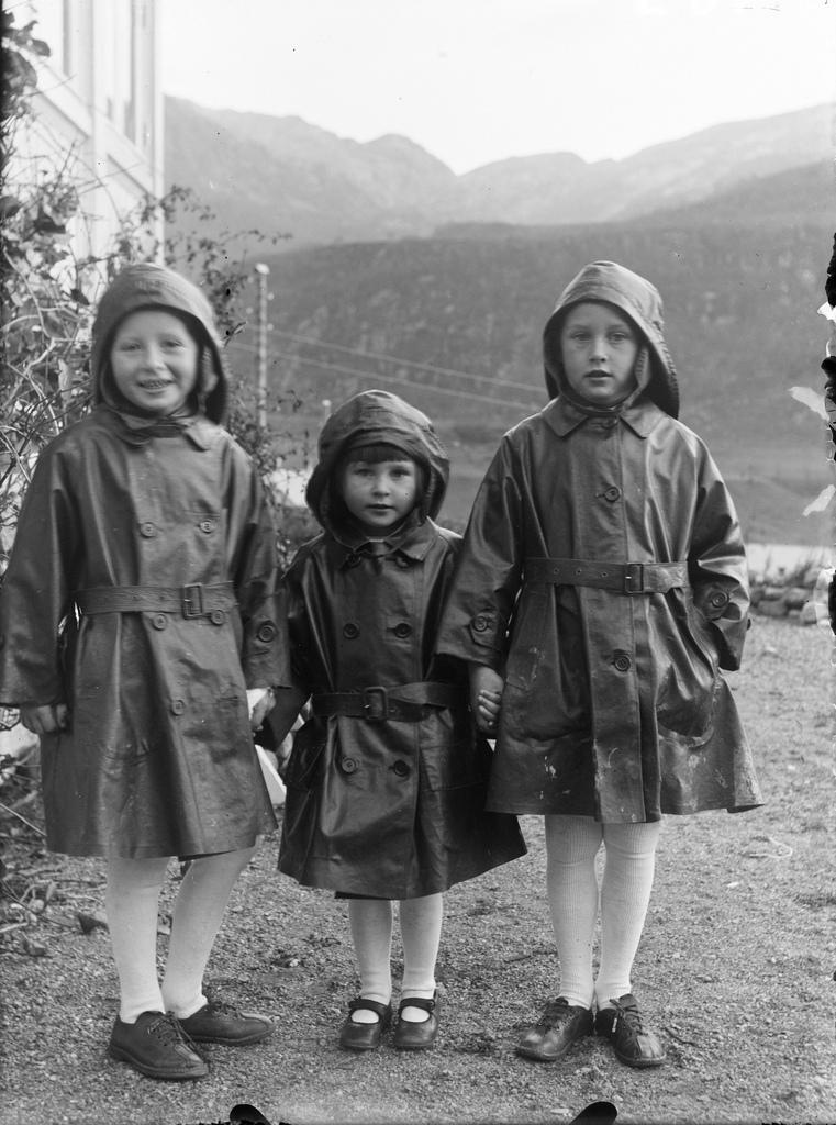 Children in rain coats, ca. 1920.