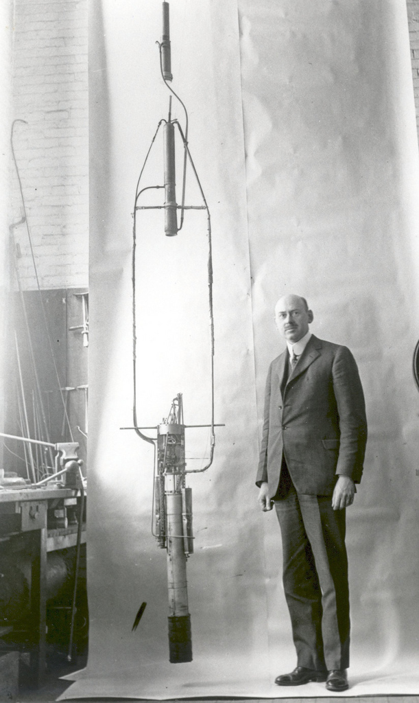 Robert Goddard with his Double Acting Engine Rocket in 1925