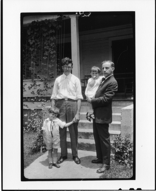 Tennessee v. John T. Scopes Trial: Howard Gale Byrd, Charles Francis Potter, with Byrd's children John and Lillian, in front of Byrd's parsonage in Dayton, Tennessee.