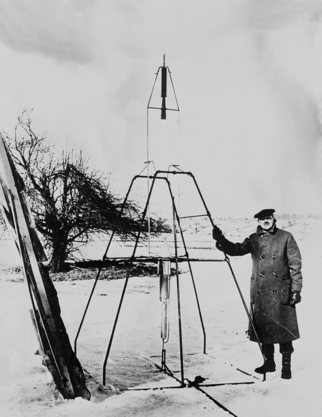 Early Rockets. Dr. Robert H. Goddard and liquid oxygen-gasoline rocket.