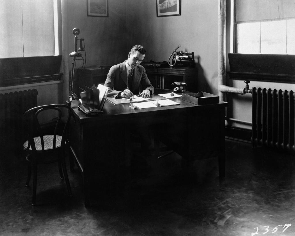 Henry Reid at his desk