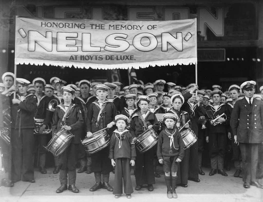 """Naval League cadets in uniform march to Hoyts De Luxe Cinema, George Street, Sydney for the film """"Nelson"""", 4 August 1928 / photographer Sam Hood"""