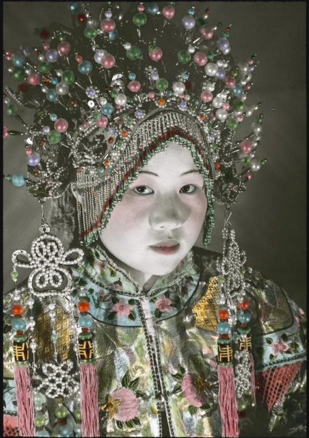 A woman wearing a headdress