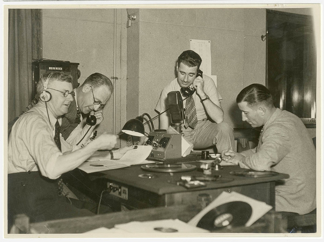 Group of radio producers in a studio, c. 1930s, by Sam Hood