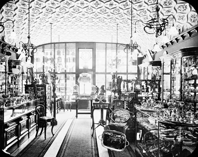 Shop Interior: silver, gold goods - indicative of wealth/trade.