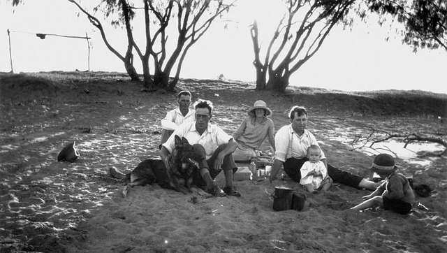 StateLibQld 1 125399 Family picnicking on the beach at Carmila, 1920-1930