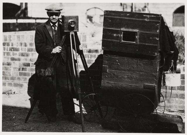 Street photographer and cart