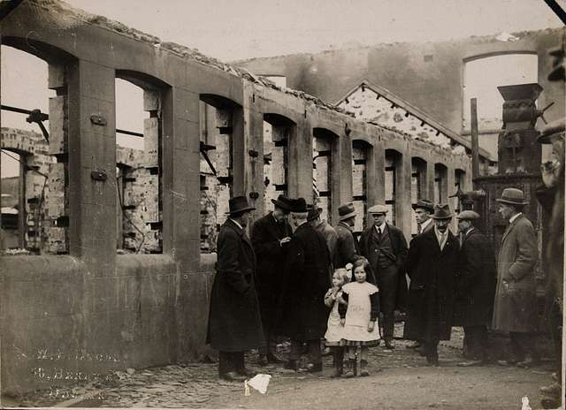 The American Committee for Relief in Ireland inspecting the ruins of Balbriggan