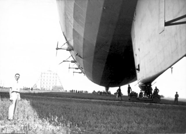 Navy Victor A. Hermann pictured in lower left corner by the USS Akron.  Contruction of first hanger at Moffett Field ARC-1932-A88-0284-4