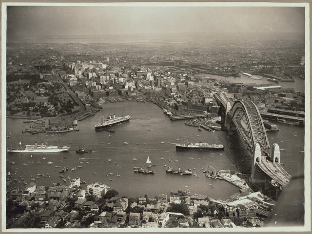 Aerial view of Sydney and Circular Quay on the day of the official opening of the Sydney Harbour Bridge, 19 March, 1932