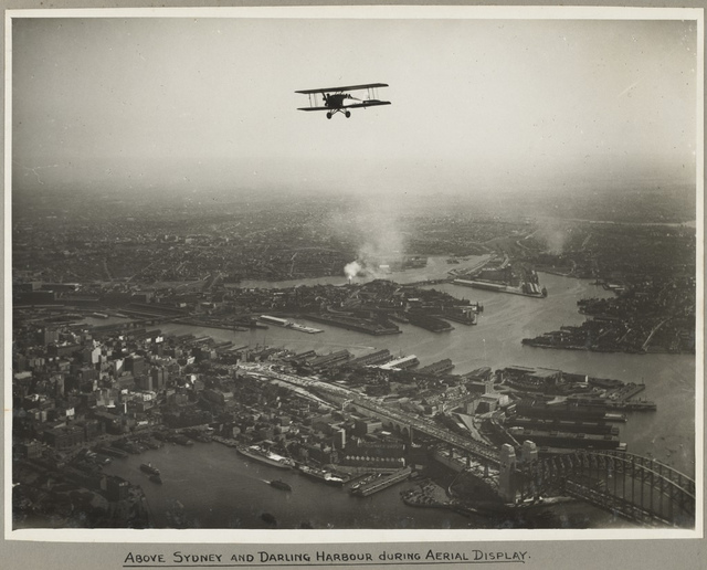 Aerial view of Sydney and the Harbour Bridge on the day of the official opening celebrations of the Sydney Harbour Bridge, 19 March, 1932