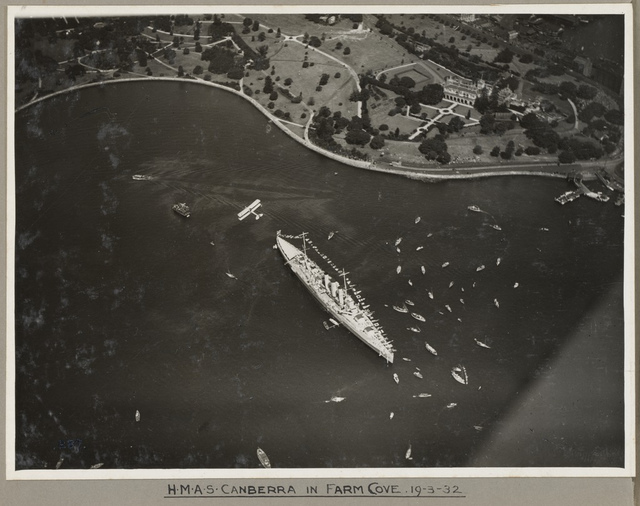 RAAF biplane flying over HMAS Canberra, Farm Cove, Sydney, 19 March 1932