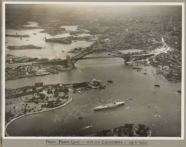 Sydney Harbour Bridge with HMAS Canberra in foreground taken from Farm Cove, 19 March 1932