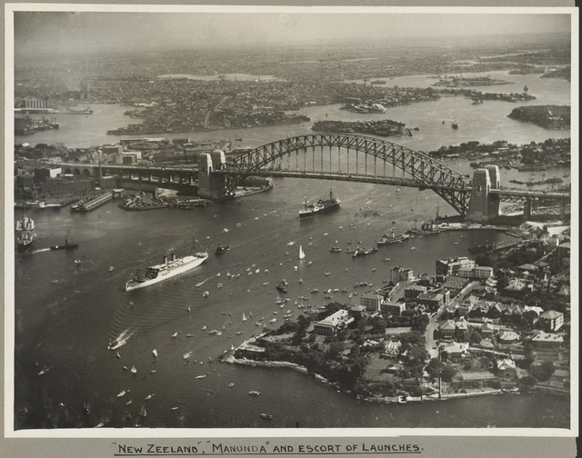 The ships New Zeeland and Manunda passing under Sydney Harbour Bridge, 19 March 1932
