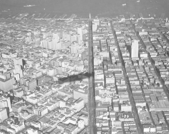Navy Aerial of San Francisco, California; over downtown lookin down Market Street toward Ferry Building (shadow of U.S. Macon) ARC-1969-A93-0075-3