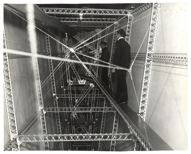 Photograph of Head-Chief Inspector of Structures Walking Through a Dirigible, ca. 1933