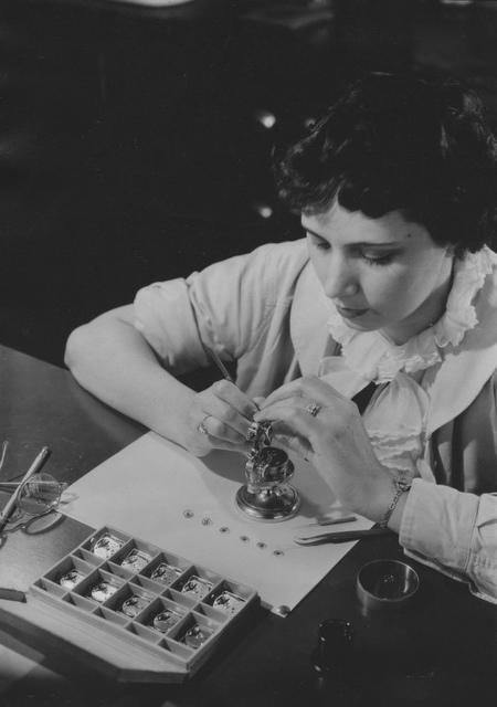 [Woman working on a watch at Bulova Watch]