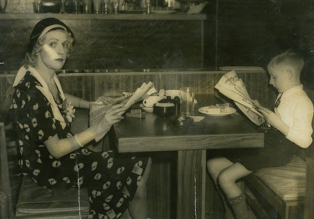 """Mary (""""Molly"""") Fraser and son John having lunch in a cafe, Sydney, ca. 1938 / photographer unknown"""