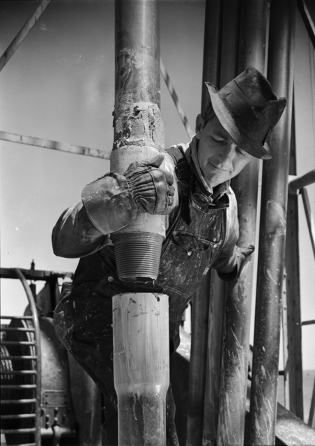 [Roughneck connecting drilling pipe, Jones & Laughlin Steel Co.]