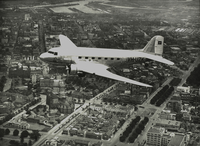 """ANA DC-3 """"Kurana"""" VH-UZK over Melbourne, c. 1940s, by unknown photographer"""