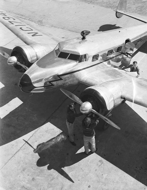 [Three Men with a Lockheed 12A Electra Junior, Delta Air Lines]