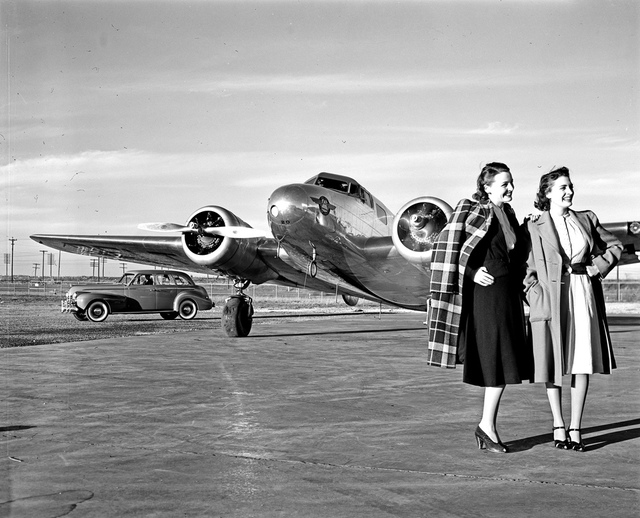 [Two Models in front of a Lockheed 10B Electra, Delta Air Lines]