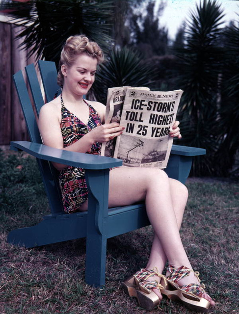 Unidentified woman in Sarasota reading about winter storms up North
