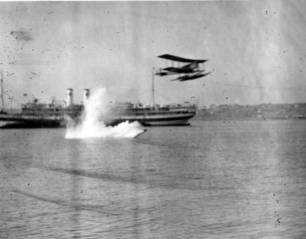 Curtiss R-6L, dropping torpedo on San Diego Bay