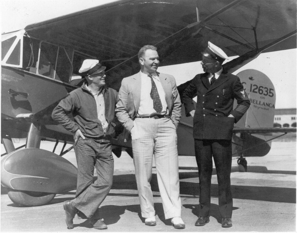 Wallace Beery with two chiefs and his Bellanca CH-400 at NAS San Diego