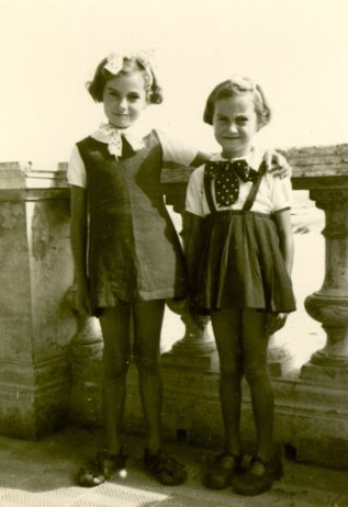 Two Young Girls With Bows