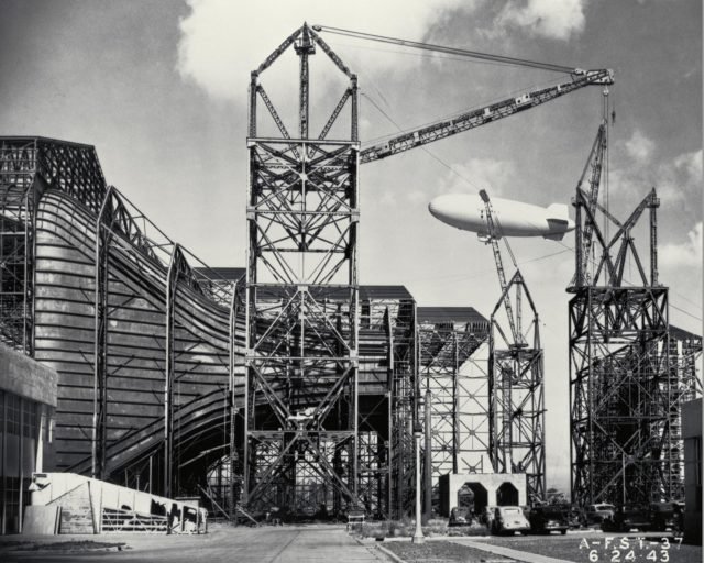 Construction of the Ames Full-Scale 40x80ft Wind tunnel. - side view of entrance cone, blimp in background ARC-1943-AFST-37