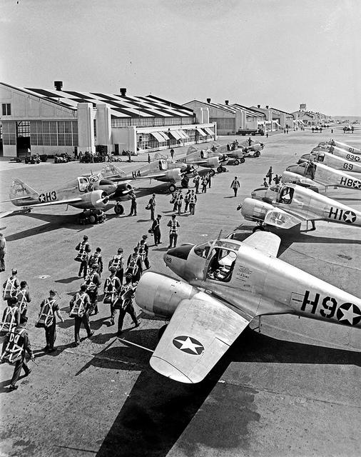 [Pilots Walking Towards Aircraft Hangar, Pepperell Manufacturing Company]
