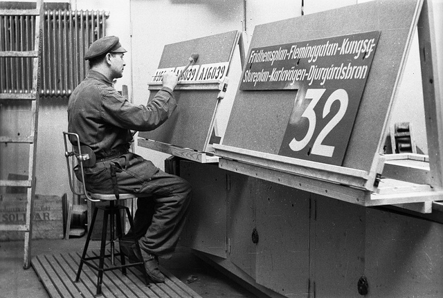 Sign painter at tram depot in Stockholm 1943