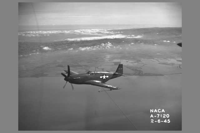 North American P-51B 'Mustang' fighter in flight over bay area. The P-51 with its new laminar-flow wing sections developed by NACA was the first airplane selected for testing of airplane drag in flight and wind tunnel comparison ARC-1945-A-7120