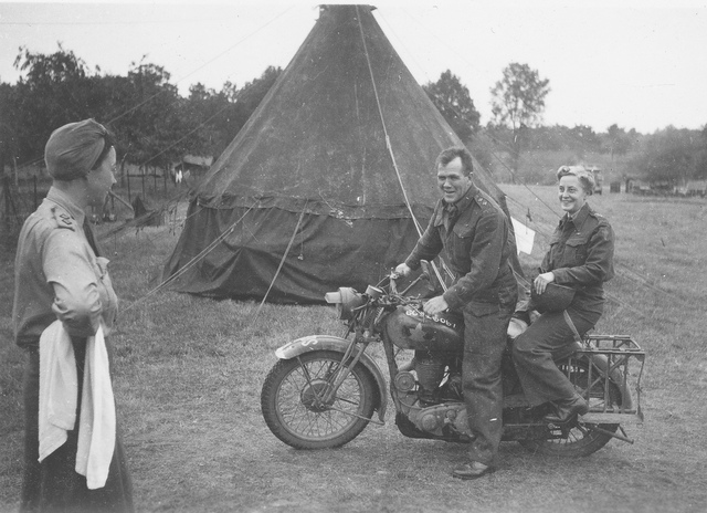 Canadian motorcylce courier and two servicewomen