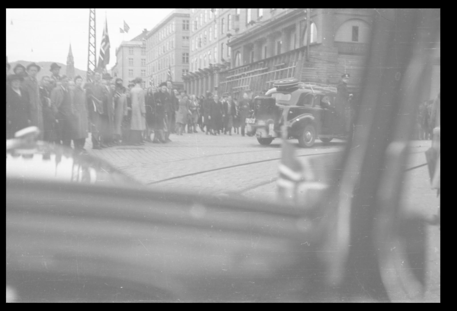 Colonel Trygve Sandvik with companions being transported into the city - 2