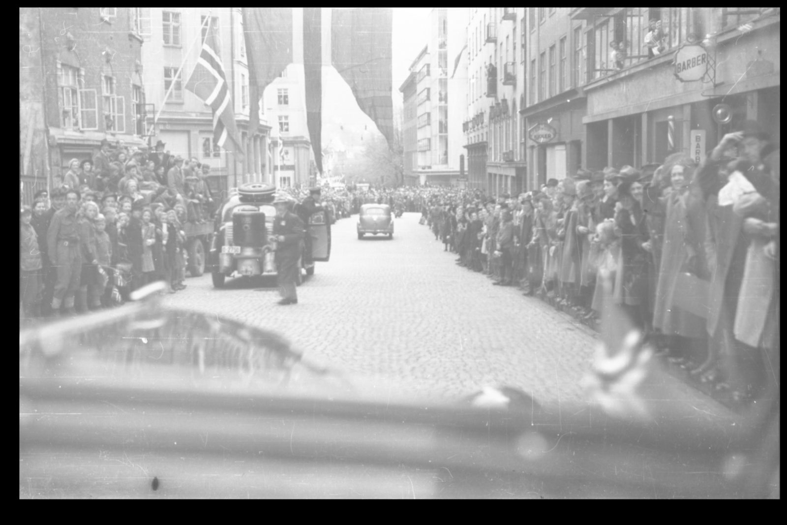 Colonel Trygve Sandvik with companions being transported into the city - 3