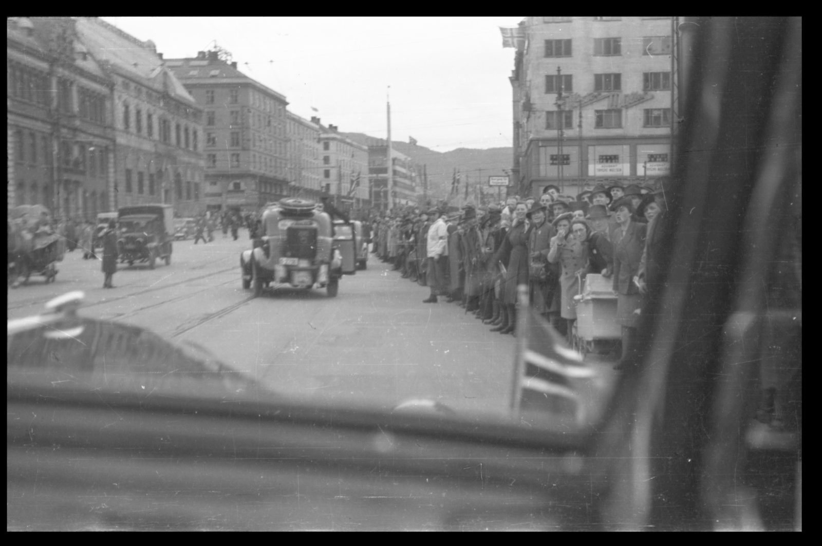 Colonel Trygve Sandvik with companions being transported into the city